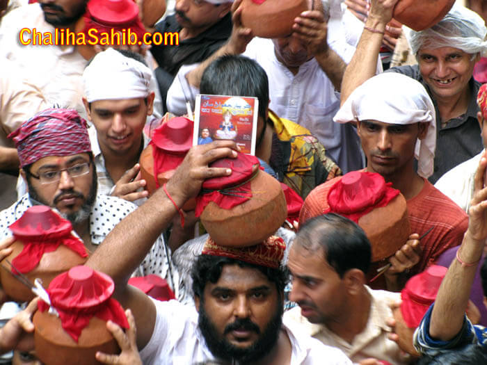 Man offering his recorded CD with Matki to God Jhulelal