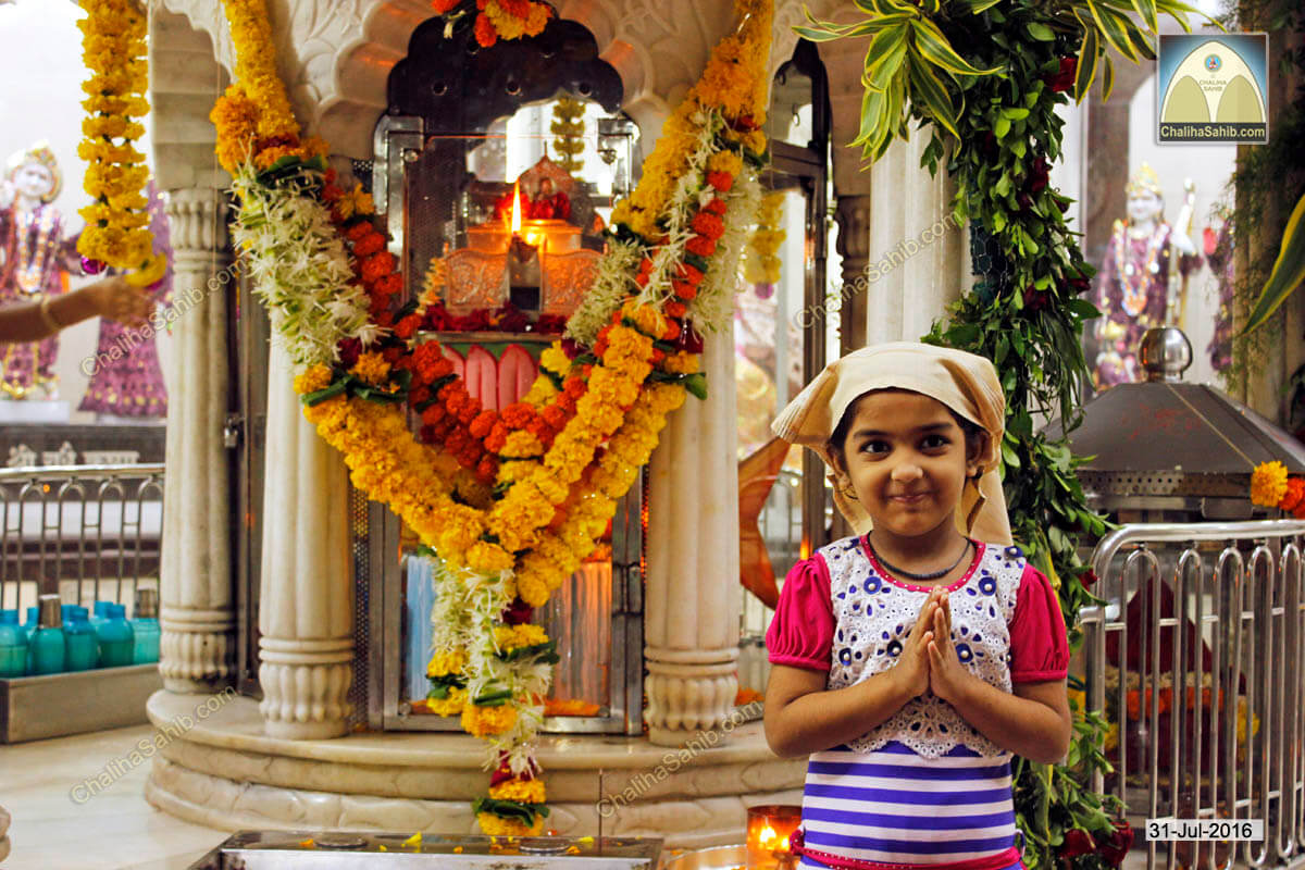 Girl praying at Akhand Jyot Chaliha Sahib 2016