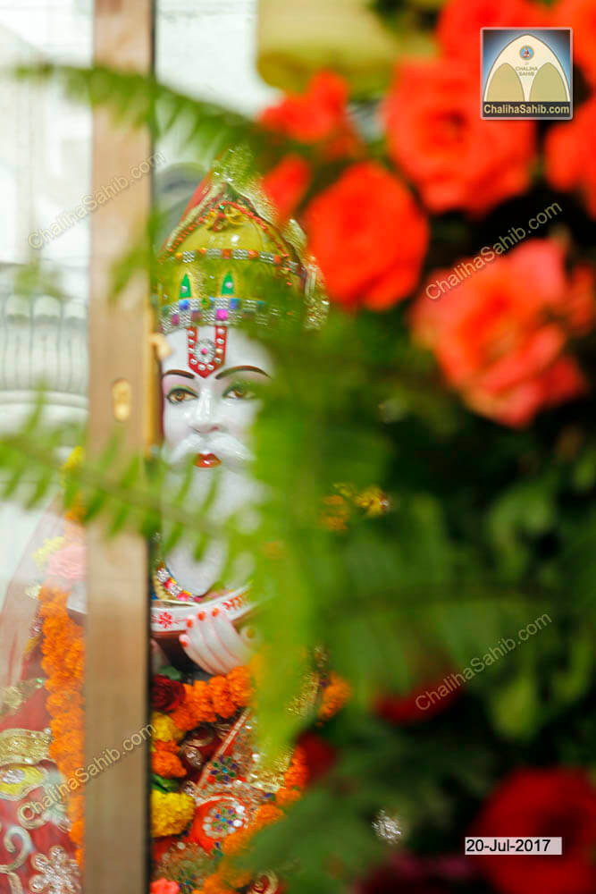 Jhulelal Sain behind Red Flowers